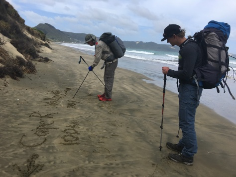 Almost to Ahipara. 100kms tramped...declaration in the sand before the high tide wiped away our signsge
