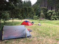Free camping for trampers in a peaceful riverside setting