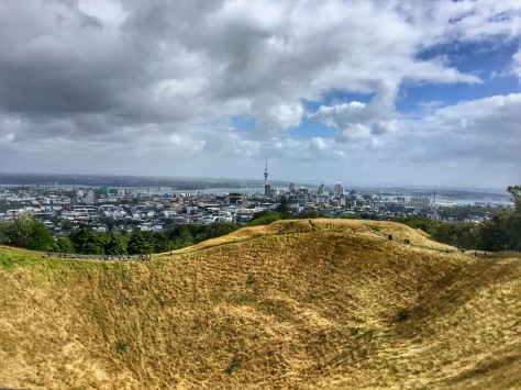 Amazing foreground image of Mt Eden's volcanic cone. Auckland sky tower is in the distance