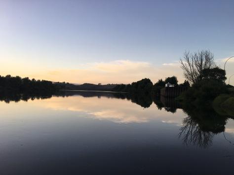Nancy loves the symmetry of sunset reflection on the Waikato River